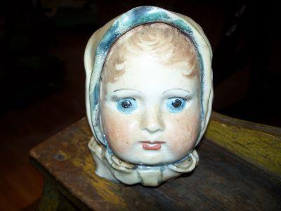 Tête  de poupée en porcelaine 1