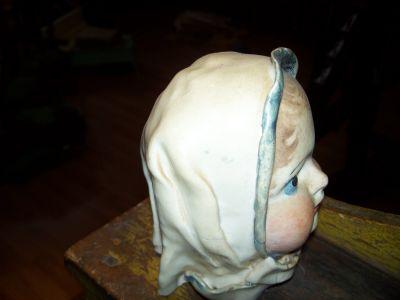 Tête  de poupée en porcelaine 2