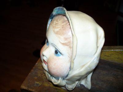 Tête  de poupée en porcelaine 3