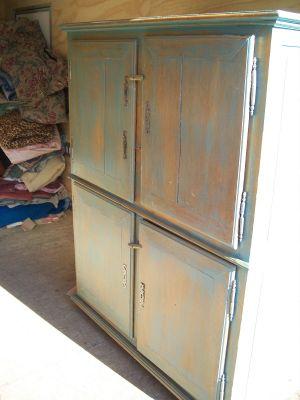 4 door pine cupboard w double raised panels. 2
