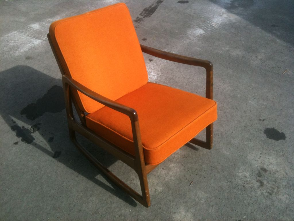 Teak Rocking Chair With Orange Cushions Made By John Stuart Antiques. Full resolution  img, nominally Width 1024 Height 768 pixels, img with #C24E09.