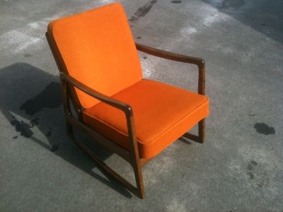 Teak rocking chair with orange cushions made by John Stuart, Antiques