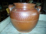 Nice old pottery jat with brown glaze and stars motives around